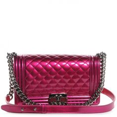 This is an authentic CHANEL Metallic Patent Calfskin Medium Boy Flap in Pink.   This chic shoulder bag is crafted of smooth luxurious patent diamond quilted calfskin leather in metallic pink with a linear quilting around the sides.  See more on http://sacredorchid.com/