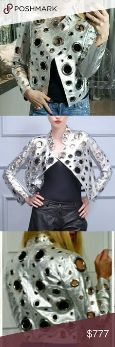 SILVER Eyelet detailed jacket RATED 5 stars: see reviews in our first Boutique @modamecouture LIMITED QUANTITY   Amazing Statement jacket. Pair over anything for a true statement look!!! I am going crazy over this jacket! Just wait until you get yours, you will go out just to wear it!   Silver jacket, has gold inside/ different size silver rings faux leather  Modeling actual jacket size Small in pic collages.  Holiday Vegas popular metallic party new years everyday casual with a twist of…