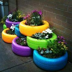 Reuse Tires And Paint Them With Bright Colors And Make A Stacked Planter  Garden Out Of