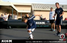 Soccer In Slow Motion with Bazooka Goal Team members.