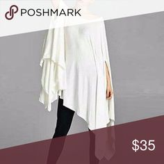 JUST IN White Tunic Poncho White ultra-soft and flowing, loose fit poncho tunic. Can be worn as a tunic top or a dress. Asymmetrical hemline. Edgy and sophisticated yet comfy. Great as a beach cover up too. 95% Rayon 5% Spandex. Made in USA. ONE SIZE FITS SMALL-XXXL Tops Tunics