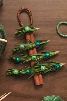 60 Easy Christmas Crafts That'll Keep Kids Entertained All Month Long DIY Christmas Ornaments Cinnamon Stick Christmas Tree Ornaments Stick Christmas Tree, Rustic Christmas Ornaments, Easy Christmas Crafts, Christmas Makes, Christmas Decorations To Make, Christmas Fun, Ornaments Ideas, Felt Ornaments, Rosemary Christmas Tree
