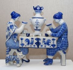 """Russian Gzhel porcelain  """"Drinking Tea"""" figurine ... women with samovar between them at tea table, cat at their feet, blue and white. ceramic, Russia"""