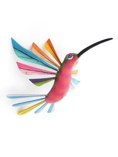 Hang this sweet little Mexican folk art bird anywhere in your home to add some glee and whimsy. - Available in green with pink belly (4 inches) and purple (4 inches) - Handcarved and handpainted in Oa