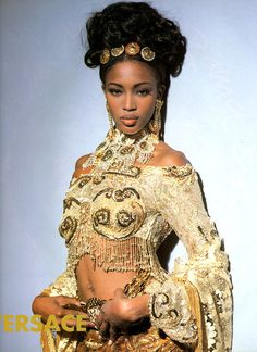 cultofmaia:  A young Naomi Cambell wearing Gianni Versace. Gold lace, sequins and rhinestones, Gianni Versace was the king ofover the top. Merging fantasy and reality, some may even say tacky but I love him! X