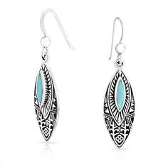 Bling Jewelry Bling Jewelry Sterling Silver Tribal Synthetic Turquoise... ($33) ❤ liked on Polyvore featuring jewelry, earrings, blue, sterling silver turquoise earrings, turquoise dangle earrings, turquoise teardrop earrings, blue earrings and long drop earrings
