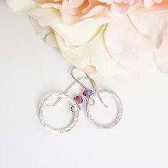 Hammered Silver Hoop Earrings with Swarovski® Fuchsia Crystals £20.00