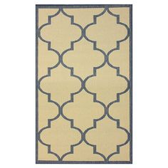 Anchor your dining set or patio seating group in chic style with this eye-catching rug, showcasing a quatrefoil motif in blue.    Produ...