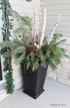 Winter urns a tutorial sounds so easy even i could do it front entryway holiday urn with birch branches fresh pomegranates and large pine cones solutioingenieria Images