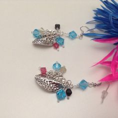 Dangling earrings with crystals and pewter hammered scalloped leaf beads