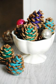 Cute - yarn and pine cones! Would be very unique for a Thanksgiving centerpiece