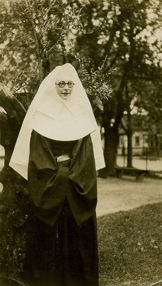 Nun in Horn Rimmed Glasses by WonderfullyStrange, via Flickr