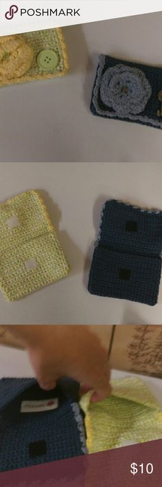 """Pair of knitted wallets / coin purses Sweet little pouch wallets, coin purses, or whatever you want to use them for. Large button and knit flower decorate the front of the lime green one. Silver key and knit flower decorate the front of the navy one. Velcro closure. Approx. 6""""x4"""". 24th & Ocean Bags Wallets"""