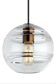 Sedona Grande Pendant from Tech Lighting: Deconstructed modern chandelier, where a glass orb is suspended from the sleek branchlike Aged Brass central hub via contrasting textured cloth covered cords to make a distinctly alluring visual statement. While the transparent clear glass orb is perfectly spherical and smooth on the exterior surface, the interior surface features gradually thickening bands of glass.Perfect for your kitchen island, dining room, or living room lighting.