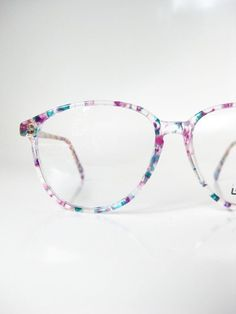 Vintage L'Amy Glasses Colorful Confetti Eyeglasses Clear Eyeglass Frames French France Womens Ladies Girls Girly Blue Purple Teal Love this shape/style, would prefer completely clear frames tho Cool Glasses, New Glasses, Glasses Frames, Clear Eyeglass Frames, Fashion Eye Glasses, Four Eyes, Purple Teal, Womens Glasses, Vintage Pink
