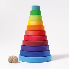This large multi-coloured conical tower has 11 pcs to stack. Hand crafted from linden wood and dyed with water based, non-toxic colours. Grimm, Linden Wood, Natural Toys, Designer Toys, Toddler Gifts, Baby Gifts, Natural Texture, Fine Motor Skills, Cool Toys
