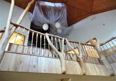Upper level geodesic dome house,natural wood, wood stairs, natural wood rails, nature light, wood columns,  chandelier,  dreamcatcher, skylights, wood ceiling, house for sale, 9121 CR 23 Brainerd MN 56401 Geodesic Dome Homes, Wood Columns, Dome House, Wood Stairs, Safe Haven, Skylights, Wood Ceilings, Wind Power