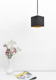 This eye-catching Concrete Cubic Pendant Light by German label GANTlights combines dark grey concrete with silver, gold or copper, resulting in a timeless and elegant designer lamp.