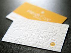 Some of the best letterpress business cards I've ever seen.  Blind embossing, color, fonts, design.