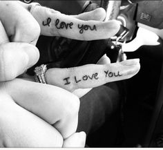 Cute tattoo! His writing on her ring finger and her writing on his ring finger.