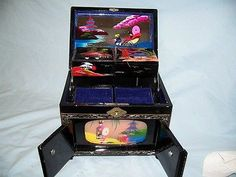 Vintage Japanese Black Laquer and Hand Painted Jewelry/music box,with Lights   I collect these boxes. I have about 4 of them. It all started when momma gave me one her daddy had from WWII
