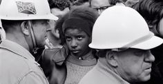 A teenager staring down a guard during the 1965 Selma to Montgomery March for voting rights. Think about it ... she as well as all the others ran the risk of being beaten, water hosed, having dogs put on them, or jail.