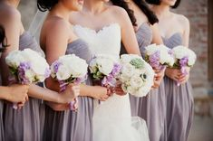 Ivory %26 Purple Bride and Bridesmaid Bouquets     Photography: This Modern Romance   Read More:  http://www.insideweddings.com/weddings/modern-wedding-at-a-spanish-courtyard-in-southern-california/780/