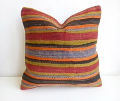 Decorative pillow cover made with a Turkish Hand woven Kilim rug. For a Gorgeous bohemian Ethnic Decor! The main colors are Terracotta, Tangerine, Blue and dark