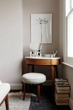 """Another way to effectively """"fight"""" your short ceilings is to bring in low-slung furniture. When you sit down, you'll be that much farther away from the ceiling, so you won't feel as cramped. If you keep the styling simple, you'll also allow more white space on your walls, creating the illusion of more actual space."""