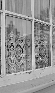 lace curtains...reminds me of windows in Germany.