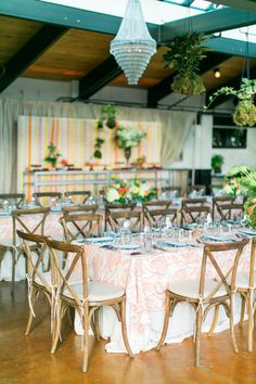 colorful wedding receptions with floral design by Lola Floral- photo by Troy Grover Photographers http://ruffledblog.com/colorful-wedding-at-hotel-ballard