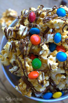 Homemade caramel corn is drizzled with chocolate and mixed with classic M&M's®, yum! #HeroesEatMMs #CollectiveBias #shop
