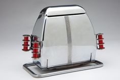 The Superlectric model 66 is one of the most uncommon Art Deco chrome and Red Catalin trim Toasters ever manufactured. Made in the 1930's by Superior Electric Product Corp. in St. Louis, MO.