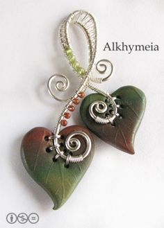 *POLYMER CLAY ~ and wire work creation, w/peridot + glass beads...100% hand made. Unica Entità by Alkhymeia