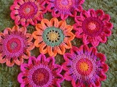 Instructions for these beautiful crochet flowers. (Need to go back to the thrift store and buy the string/yarn I found there!  Didn't think I'd need orange & pink, but wow!)