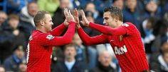 Un par de Cracks, Rooney y Van Persie.