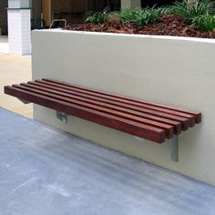 Check out how the dark timber contrasts against the white concrete wall. The stylish City Seat by Urban FF. Backyard Seating, Small Backyard Landscaping, Patio, Outdoor Sauna, Outdoor Walls, Outdoor Decor, Wall Bench, Wall Seating, White Concrete