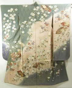 This is a graceful Furisode kimono with fan with cherry blossom and butterfly motifs, which are dyed.