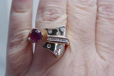 Unusual yellow gold, ruby and diamond ring by Estate Jewelry