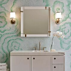 Green and white mosaic tiled bathroom with square mirror