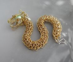 This dragon is so amazing, I had to pin it twice! Golden and silver chainmaille dragon bracelet by studiodct on Etsy, Wire Jewelry, Jewelry Crafts, Beaded Jewelry, Jewelery, Jewelry Ideas, Dragon Bracelet, Dragon Jewelry, Handmade Rings, Handmade Jewelry