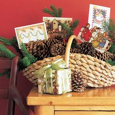 This Christmas card basket works wonders for an anywhere-you-need holiday decoration. Take a woven basket and add pinecones to make a Christmas display for your favorite greeting cards. Our recommendation? Pinecones make natural card stands, and add to the natural Christmas decoration—just clip a few, if necessary. Accent the Christmas card basket with sprigs of pine or berries.