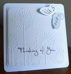 handmade card ... White On White ,,, layers ... main panel with embossing folder dandelions ... punched butterfly ... sweet card ...