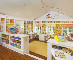 Amazing kids' playroom/craft room by Milieu Design Group