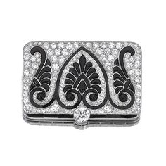 Onyx and diamond brooch, Cartier, circa 1915 The plaque with calibré-cut and buff-topped onyx in a palmette design, highlighted with circular- and single-cut diamonds, mounted in platinum