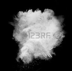 Freeze motion of white dust explosion isolated on black background Stock Photo