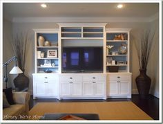 Media center / shelf unit for long wall in family room?  I love that the back is painted a different color than the wall.