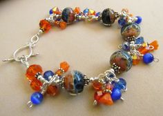 Lampwork Beaded Charm Bracelet orange and Blue by Harleypaws