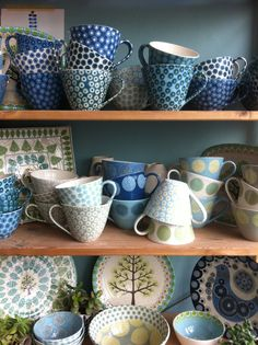 Matron Moye, British potter. Detailed surface decoration, folky, country, pretty, retro.