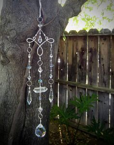 Enjoy the rainbows with this gorgeous crystal chandelier suncatcher! The pictures dont do it justice. Hang in front of a window, or from a tree and watch it sparkle! I have wire wrapped Swarovski crystal beads, crystal prisms, glass beads, a double terminated quartz crystal, and hung